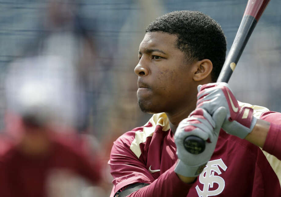 Florida State's Jameis Winston takes batting practice before a spring training exhibition game against the New York Yankees Tuesday, Feb. 25, 2014, in Tampa, Fla. Winston is the 2013 Heisman Trophy winner. (AP Photo/Chris O'Meara)