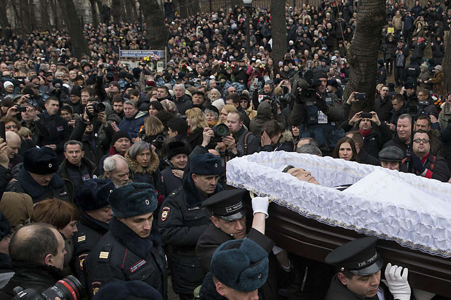 People follow the coffin of Boris Nemtsov during a farewell ceremony at the Sakharov center in Moscow, Russia, Tuesday, March 3, 2015. Mourners are lining up outside a Moscow human rights center for the funeral of murdered Nemtsov. a charismatic Russian opposition leader and sharp critic of President Vladimir Putin, who was gunned down on Friday, Feb. 27, 2015 near the Kremlin. (AP Photo/Pavel Golovkin)