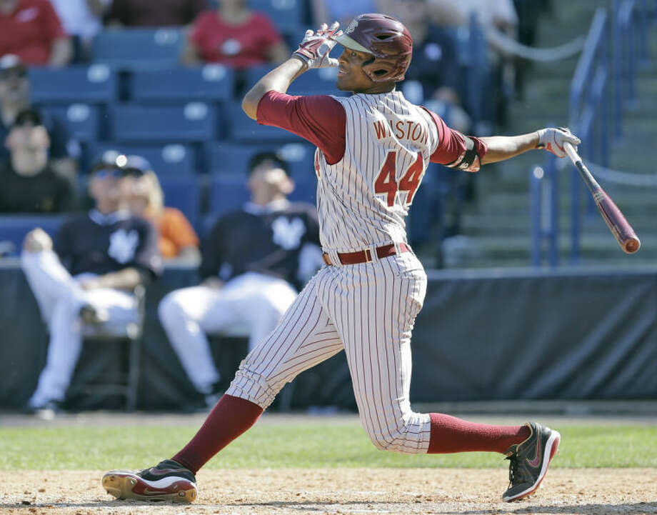 Florida State's Jameis Winston swings at an eighth inning pitch during a spring training exhibition game against the New York Yankees Tuesday, Feb. 25, 2014, in Tampa, Fla. He eventually struck out. Winston is the 2013 Heisman Trophy winner. (AP Photo/Chris O'Meara)