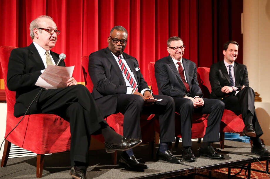 "Dr. Tommie Jackson, the Rev. Rob Schneck and Congressman Jim Himes speak during the panel following ""The Armor of Light"" screening at the Avon Theatre in Stamford."