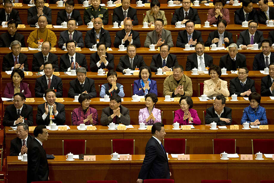 Chinese President Xi Jinping, bottom right, and Chinese Premier Li Keqiang, left, arrive for the opening session of the Chinese People's Political Consultative Conference in Beijing's Great Hall of the People, Tuesday, March 3, 2015. The more than 2,000 members of China's top legislative advisory body convened their annual meeting Tuesday, kicking off a political high season that will continue with the opening of the national congress later in the week. (AP Photo/Ng Han Guan)