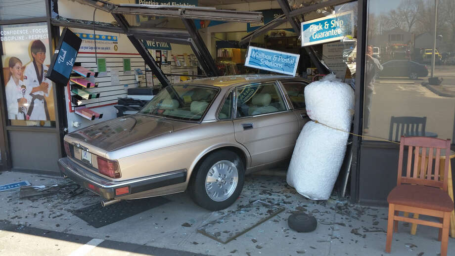 Hour photo/Alex von KleydorffA car crashed into the UPS Store at 304 Main Ave. in Norwalk on Wednesday afternoon. No serious injuries were reported.