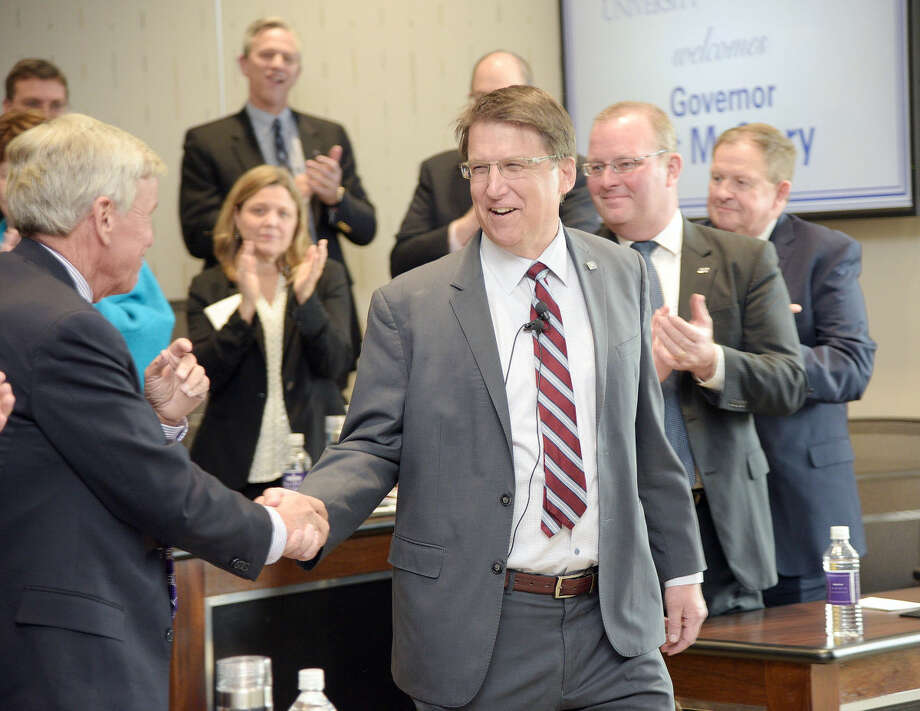 FILE - In this Feb. 2016 photo, Gov. Pat McCrory greeted presidents from private and public universities throughout the state at the President's Forum held at Cottrell Hall on the campus of High Point University, in N.C. North Carolina Gov. McCrory signed a new law limiting LGBT protections in his state by overriding local anti-discrimination laws. He faces voters this fall in a re-election effort against the state's Democratic attorney general. (Laura Greene/The Enterprise via AP, File) MANDATORY CREDIT (/The Enterprise via AP) MANDATORY CREDIT
