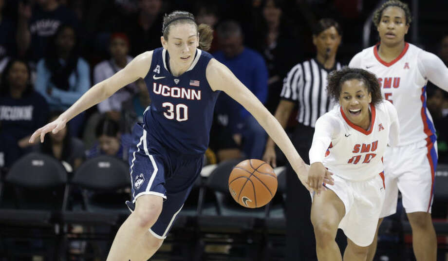 Connecticut forward Breanna Stewart (30) steals the ball from SMU guard Kiara Perry (00) during the first half of an NCAA college basketball game, Tuesday, Feb. 25, 2014, in Dallas. (AP Photo/LM Otero)