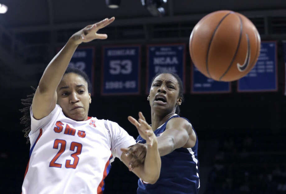 Connecticut guard Brianna Banks (13) and SMU guard Keena Mays (23) battle for control of the ball during the first half of an NCAA college basketball game Tuesday, Feb. 25, 2014, in Dallas. (AP Photo/LM Otero)