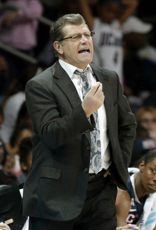 Connecticut head coach Geno Auriemma yells from the sidelines during the first half of an NCAA college basketball game against SMU Tuesday, Feb. 25, 2014, in Dallas. (AP Photo/LM Otero)