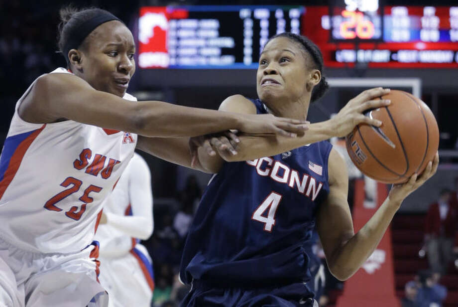 Connecticut guard Moriah Jefferson (4) drives against SMU guard Krystal Johnson (25) during the first half of an NCAA college basketball game, Tuesday, Feb. 25, 2014, in Dallas. (AP Photo/LM Otero)