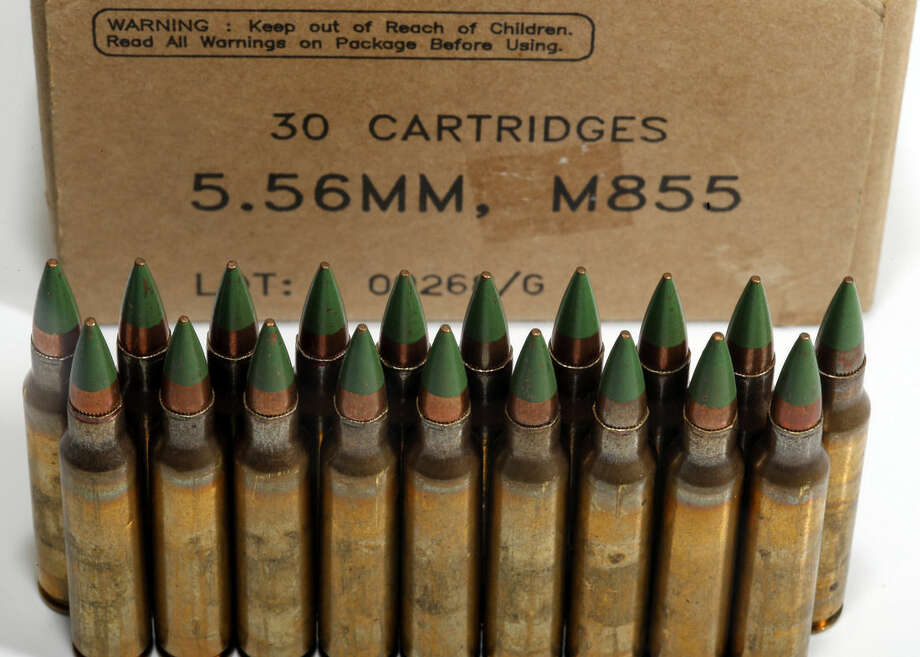 "Green tip, M855 5.56mm ammunition is photographed Monday, March 2, 2015, in Fort Washington, Md. The Bureau of Alcohol, Tobacco, Firearms and Explosives is proposing the ban of ""M855 green tip"" or ""SS109"" rounds with certain types of metal cores. (AP Photo/Alex Brandon)"