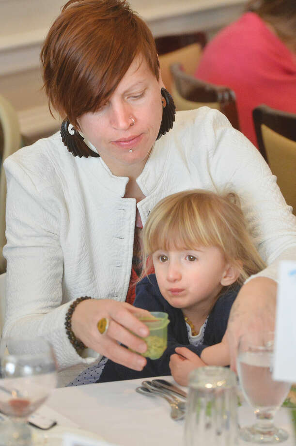 Hour Photo/Alex von Kleydorff Kate Bagnati and 3 1/2 yr old daughter Wolf who benefits from STAR's programs enjoy lunch before listening to Elizabeth Smart speak at STAR Inc. 4th Annual Speaker's Luncheon at Woodway Country Club