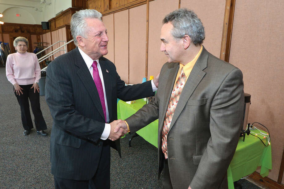 Hour Photo/Alex von Kleydorff Mayor Harry Rilling congratulates Gerald Foley during a farwell party after his more than 15 years of service to the city