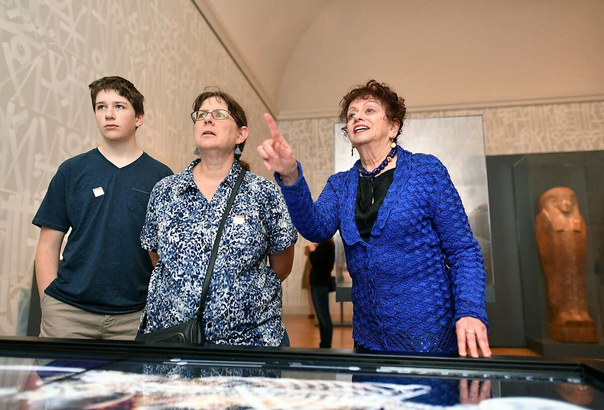 Renee Dreyfus (R) describes to visitors what is seen in a virtual dissection view of a mummy as part of The Futures of the Past exhibit at the Legion of Honor in San Francisco on June 10, 2016. The exhibit features two preserved mummies and a virtual dissection table.