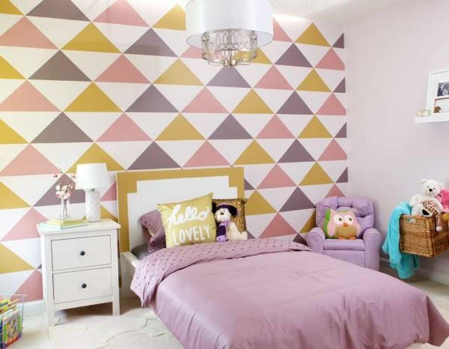 An accent wall with bold designs can breathe new life into a room.