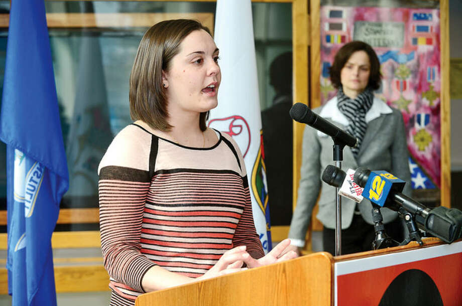 Hour photo / Erik Trautmann ... Erica Lafferty, daughter of slain Sandy Hook Elementary School Principal Dawn Hochsprung, speaks Wednesday at the Stamford Government Center as Stamford Mayor David Martin joins Mayors against Illegal Guns during a ceremony sponsored by The Enough Campaign.