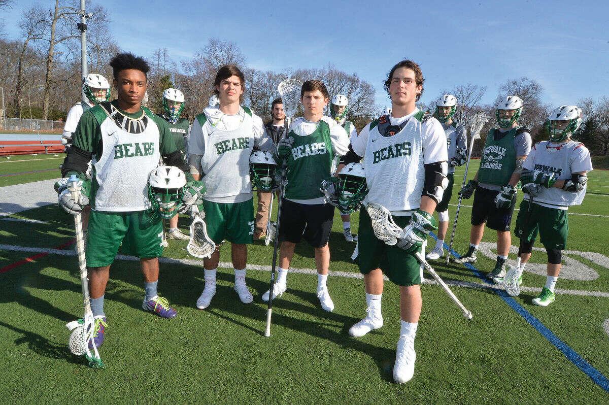 Hour Photo/Alex von Kleydorff Dakari Eason, Harrison Heffernan, Nick LaFranco and Joey Laracca surrounded by Senior Norwalk Lacrosse player