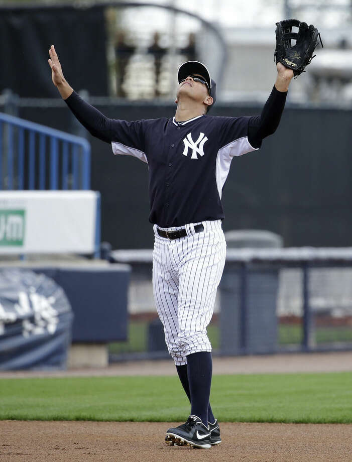 New York Yankees' Alex Rodriguez waits to catch a fly ball during a spring training baseball workout, Monday, March 2, 2015, in Tampa, Fla. (AP Photo/Lynne Sladky)