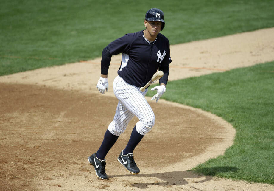 New York Yankees' Alex Rodriguez tosses his bat as he runs to first on a fly ball during an intrasquad game at a spring training baseball workout, Monday, March 2, 2015, in Tampa, Fla. (AP Photo/Lynne Sladky)