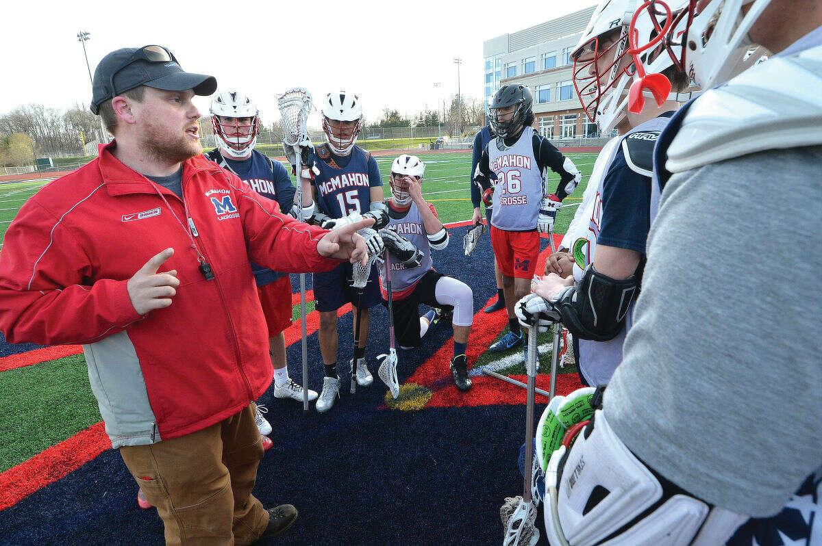 Hour Photo/Alex von Kleydorff McMahon Boys Lacrosse coach Joe Dana
