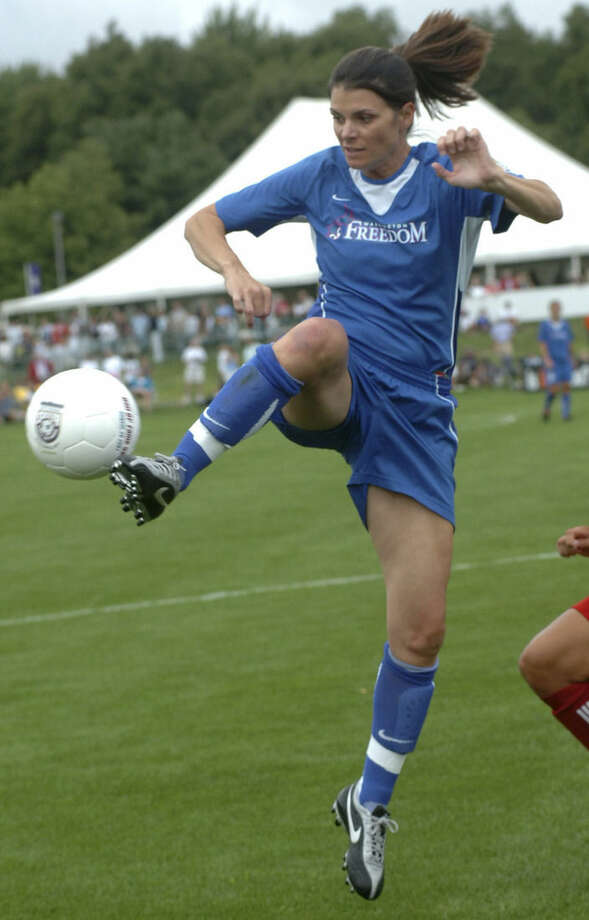 FILE -- In this file photo taken on Aug. 26, 2007, Mia Hamm, playing for the Washington Freedom, takes a pass while playing against the SoccerPlus Connecticut Reds during the Hall of Fame Game at the National Soccer Hall of Fame in Oneonta, N.Y. Retired women's soccer star Mia Hamm has been nominated to Italian club Roma's board of directors. Roma is traded on the Milan stock exchange and the nomination was made at a club shareholder meeting Monday, Oct. 27, 2014. The 42-year-old Hamm helped the United States to two World Cup titles, including the inaugural edition in 1991 in China, and won the women's FIFA world player of the year award in 2001 and 2002 - the first two times that the honor was given. (AP Photo/Hans Pennink)