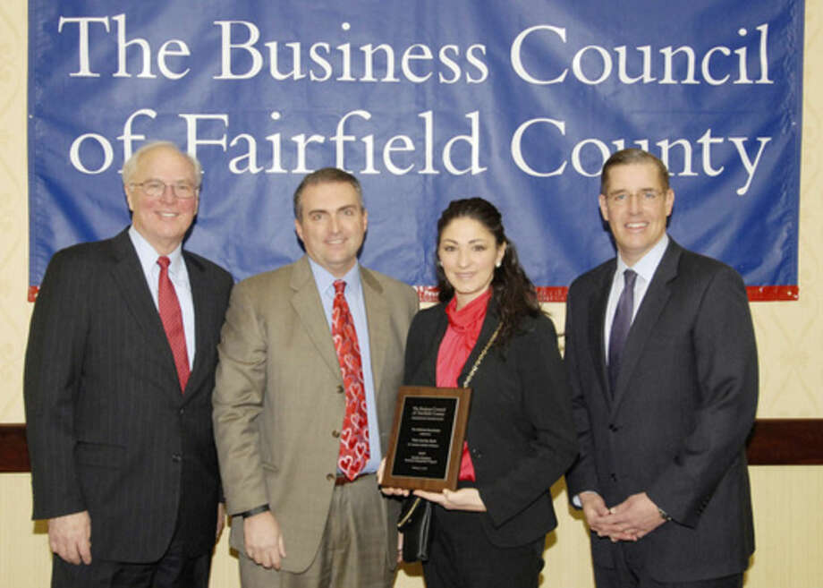 (L to R) Christopher Bruhl, president & CEO, The Business Council of Fairfield County, Eric Thompson, principal, BlueBack, LLC., Vanessa Calabro, vice president, human resource manager, First County Bank, and Matthew Fair, regional sales director, First Niagara Risk Management and co-chair of the 2015 Healthy Workplace Employer Recognition Event.