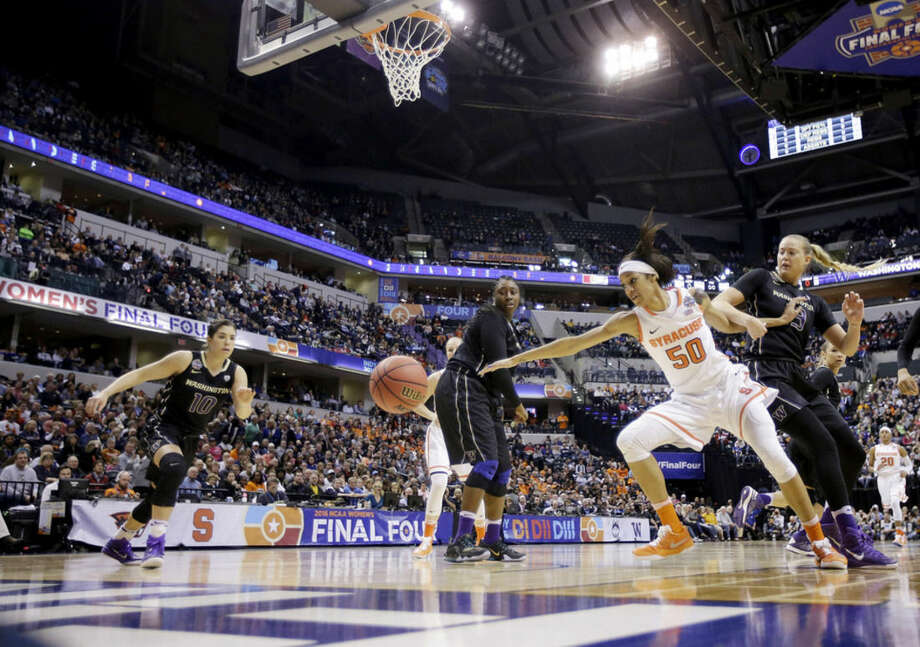 Syracuse's Briana Day (50) goes for a loose ball against Washington's Katie Collier (13) as Kelsey Plum (10) moves in during the first half of a national semifinal game at the women's Final Four in the NCAA college basketball tournament Sunday, April 3, 2016, in Indianapolis. Washington's Chantel Osahor (0) looks on. (AP Photo/AJ Mast)