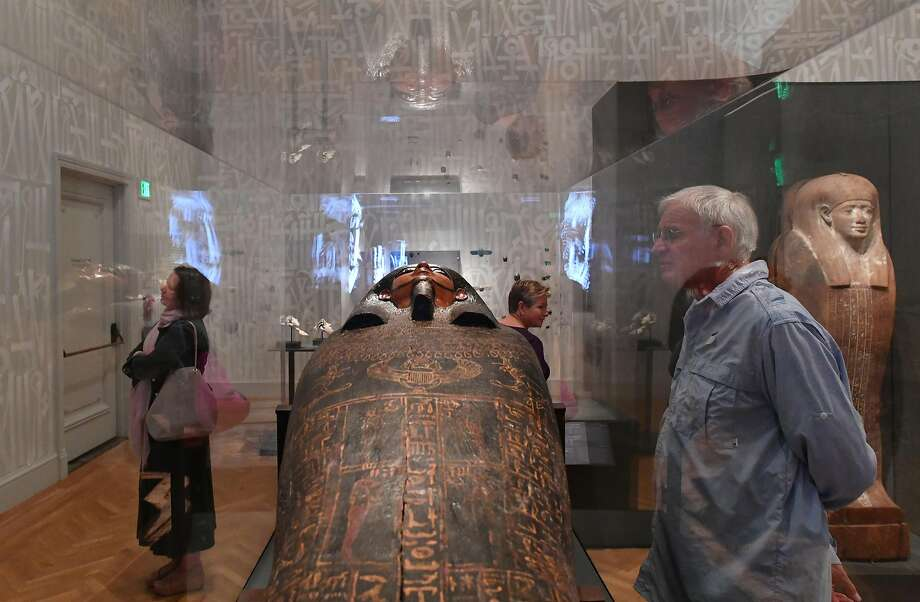 "Visitors to the Legion of Honor explore ""The Future of the Past"" exhibit, which features anatomical details and more of a pair of ancient Egyptian mummies. Photo: Josh Edelson, JOSH EDELSON / SAN FRANCISCO CHRONICLE"