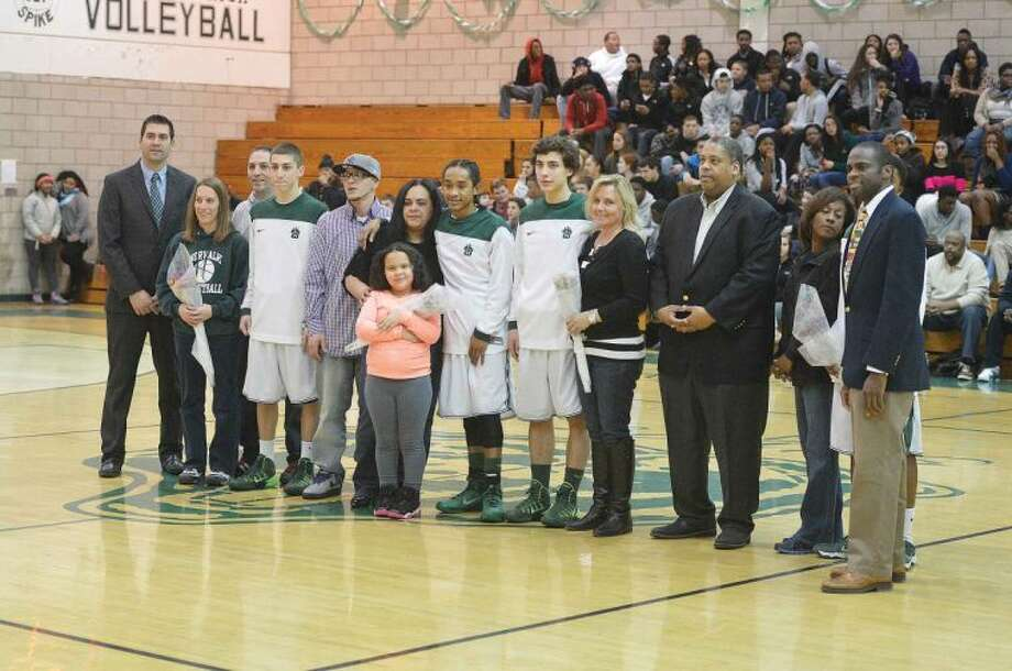 Hour Photo/Alex von Kleydorff Seniors and family celebrate senior night at Norwalk High.
