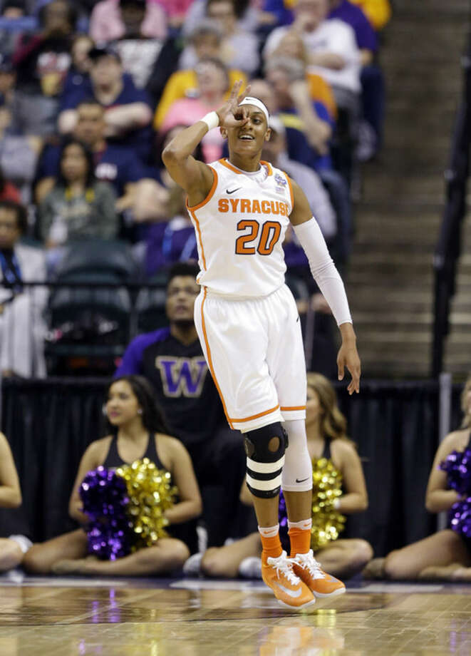 Syracuse's Brittney Sykes (20) reacts to a three-point basket during the first half of a national semifinal game against Washington, at the women's Final Four in the NCAA college basketball tournament Sunday, April 3, 2016, in Indianapolis. (AP Photo/Michael Conroy)
