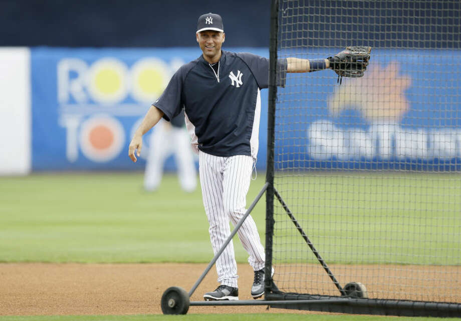 New York Yankees shortstop Derek Jeter looks on during batting practice before an exhibition baseball game against the Pittsburgh Pirates Thursday, Feb. 27, 2014, in Tampa, Fla. (AP Photo/Charlie Neibergall)