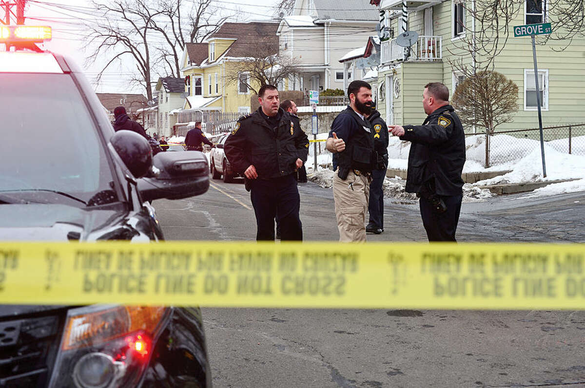 Hour photo / Erik Trautmann Norwalk police investigate a stabbing at the corner of South Main and Grove as students arrive home from school Tuesday afternoon.