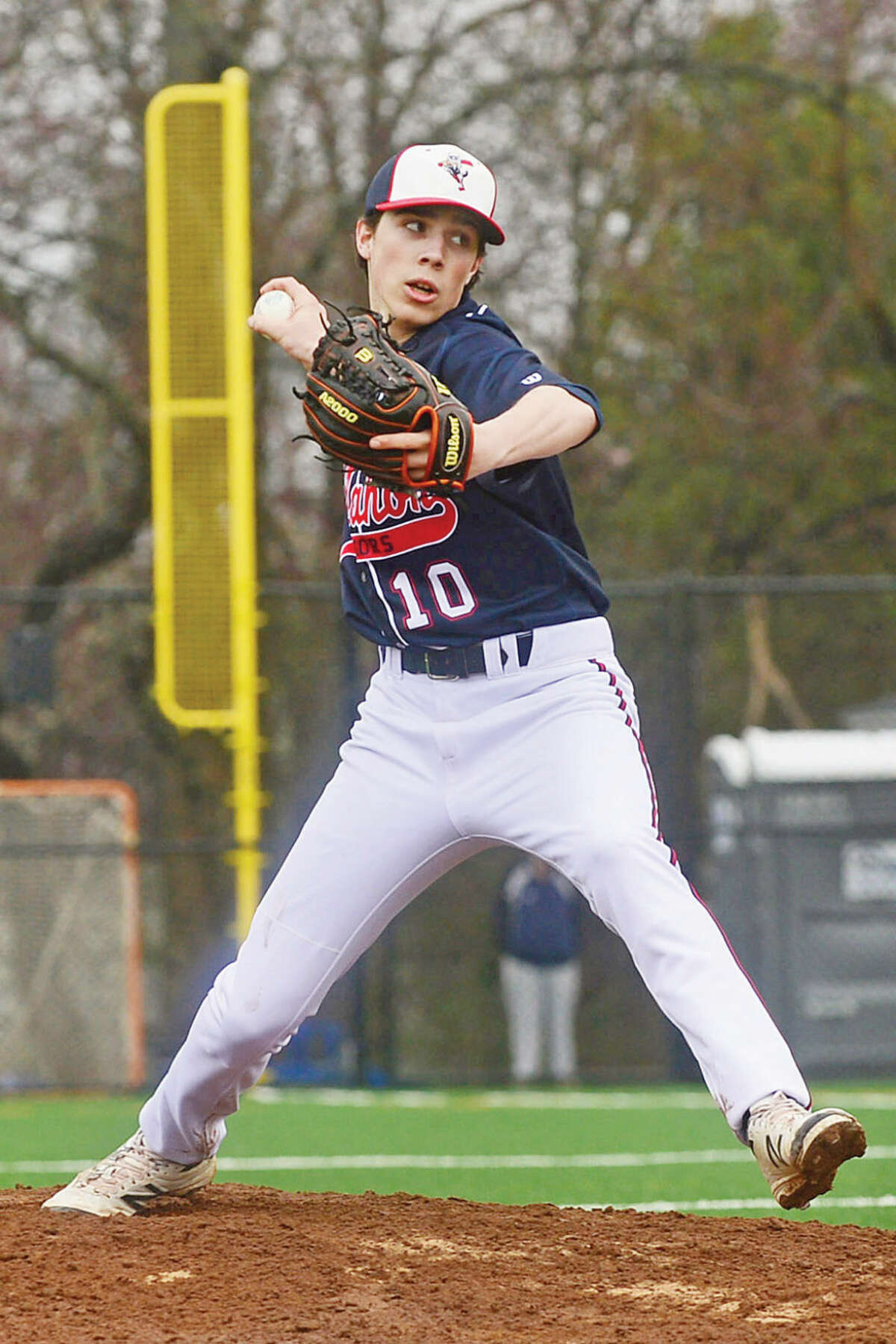 Hour photo / Erik Trautmann Brien McMahon High School' Jeff Vitatoe pitches against Norwalk High School in their game Saturday