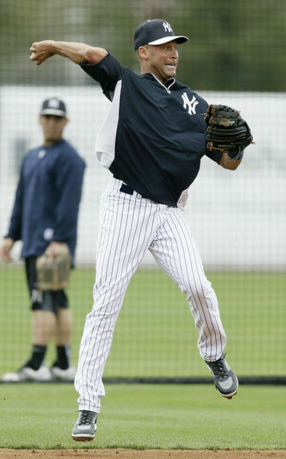 New York Yankees shortstop Derek Jeter warms up before an exhibition baseball game against the Pittsburgh Pirates Thursday, Feb. 27, 2014, in Tampa, Fla. (AP Photo/Charlie Neibergall)