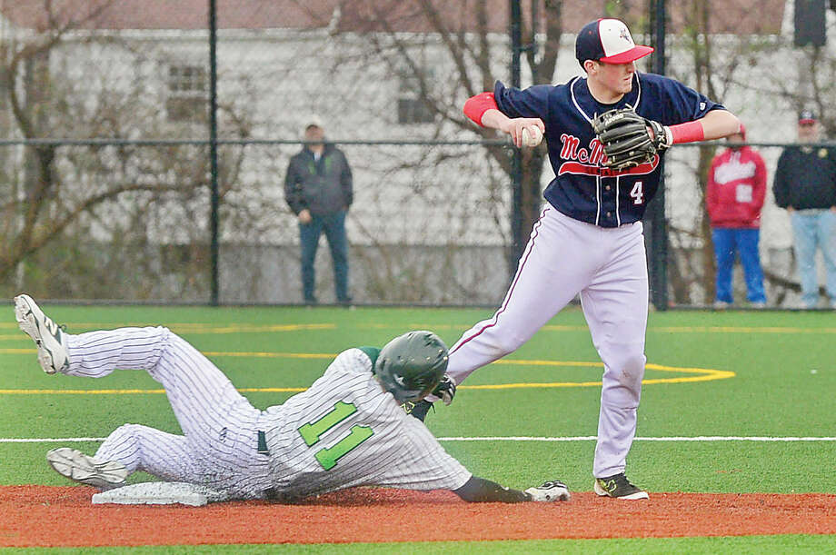 Hour photo / Erik Trautmann Brien McMahon High School shortstop Chris Giordano tags out Norwalk High School's Moe Ortiz in their game Saturday