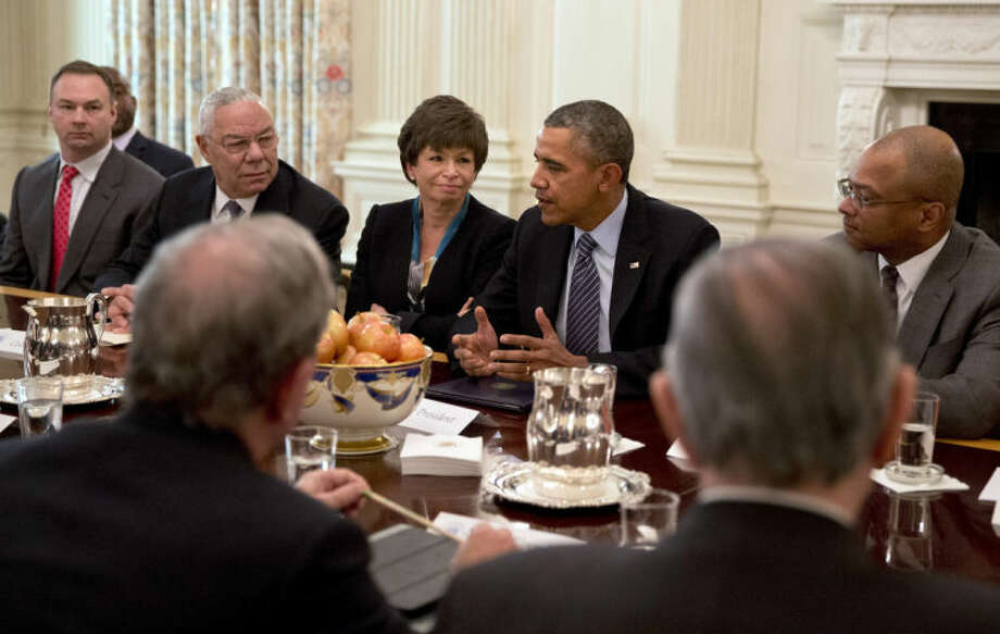 "President Barack Obama, next to White House Senior Adviser Valerie Jarrett, left, and former Secretary of State Colin Powell, meets with foundation and business leaders in the State Dining Room of the White House in Washington, Thursday, Feb. 27, 2014, where he discussed his ""My Brother's Keeper"" initiative to expand opportunity for minority boys and young men. Former Lakers basketball star Magic Johnson, far left partially obscured, also attended. (AP Photo/Jacquelyn Martin)"