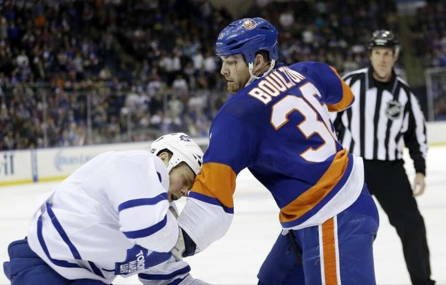 New York Islanders' Eric Boulton (36) fights Toronto Maple Leafs' Tim Gleason during the second period of an NHL hockey game Thursday, Feb. 27, 2014, in Uniondale, N.Y. (AP Photo/Frank Franklin II)