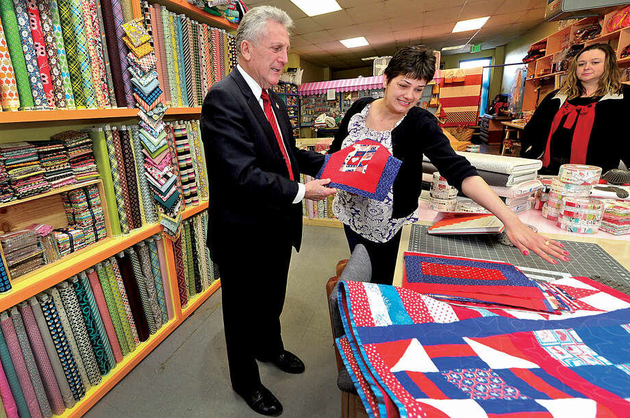 Hour photo / Erik Trautmann Norwalk Mayor Harry Rilling chats with business owner Christie Ruiz as the mayor visits Christie's Quilting Boutique as part of his small business intiiative Wednesday.