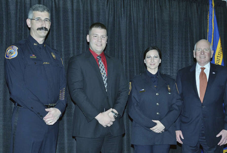 Contributed photoF left to right: Chief of Police Dale Call, Officer Michael Tomanelli, Detective Sharon Russo and First Selectman Jim Marpe)