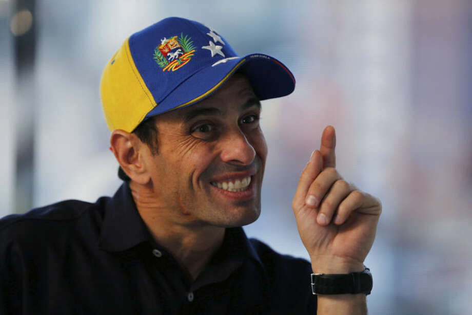 In this Feb. 25, 2014 photo, Opposition leader and Mirada's State governor Henrique Capriles gestures during an interview at his office in Caracas, Venezuela. Capriles says the opposition has put its differences over strategy behind them, adding that the government may have miscalculated its response to the protests as well. (AP Photo/Fernando Llano)
