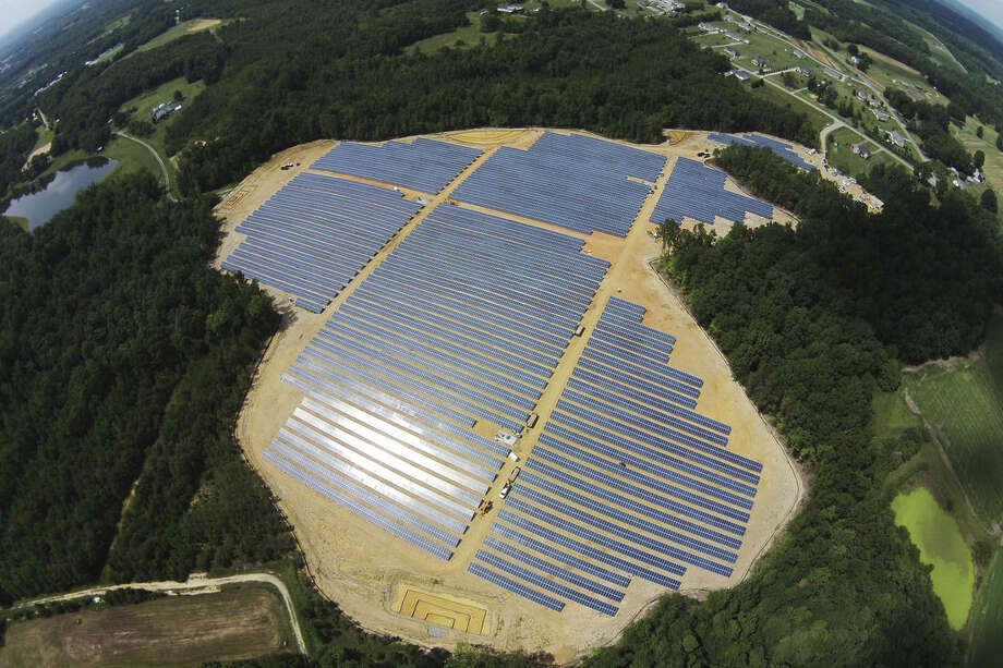 This Sept. 30, 2015 aerial photo provided by Cypress Creek Renewables, shows a commercial solar farm built on farmland by Cypress Creek Renewables in Catawba County, N.C. Less than a year after New York banned fracking, dashing the hopes of farmers who had hoped to reap royalties from natural gas leases, the commercial solar industry is courting landowners for energy production. Gov. Andrew Cuomo administration's initiatives aimed at promoting local renewable energy generation, reducing greenhouse gas emissions and generating 50 percent of the state's energy from renewable sources by 2030 are bringing solar developers to the state like Cypress Creek Renewable. (Cypress Creek Renewables via AP)