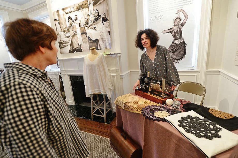 Hour photo / Erik Trautmann The Norwalk Historical Society's Meet the Artist Series features fashion designer, Riki Verveniotis of Riki & Pookey, Ltd/Go Lightly Clothing, right, at the Lockwood House Saturday.
