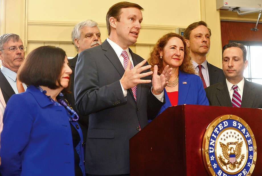 Hour photo / Erik Trautmann U.S. Senator Chris Murphy and U.S. Representative Elizabeth Esty hold a press conference at South Norwalk Train Station Friday as part of 'Fed Up Campaign' aimed at drawing attention to Connecticut's poor transportation infrastructure.