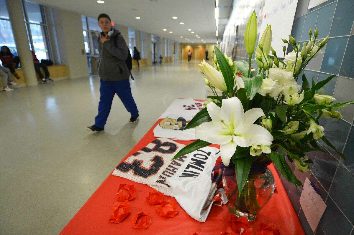 Hour Photo/Alex von Kleydorff Flowers and jerseys on a table in memoriam of Maurice