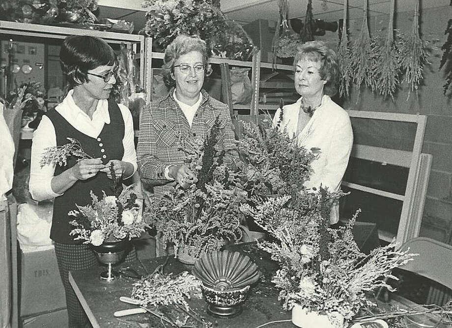 Hour archivesNorwalk Garden Club members prepare for an art exhibit in 1975.