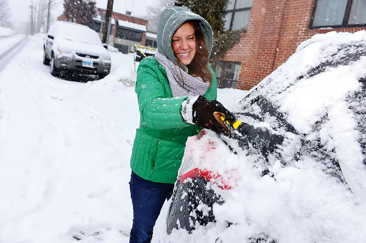 Hour photo / Erik Trautmann Local residents including Justyna Szwonder deal with the most recent snowfall Thursday morning.
