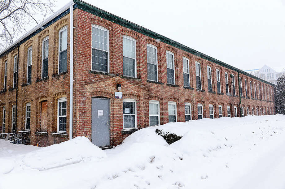 Hour photo / Erik Trautmann The former hat factory at 3 Quincy Street is being preserved and moved across the street in the midst of Waypointe development