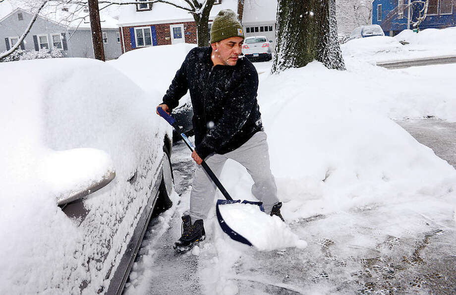 Hour photo / Erik Trautmann Local residents including George Lorenzana deal with the most recent snowfall Thursday morning.