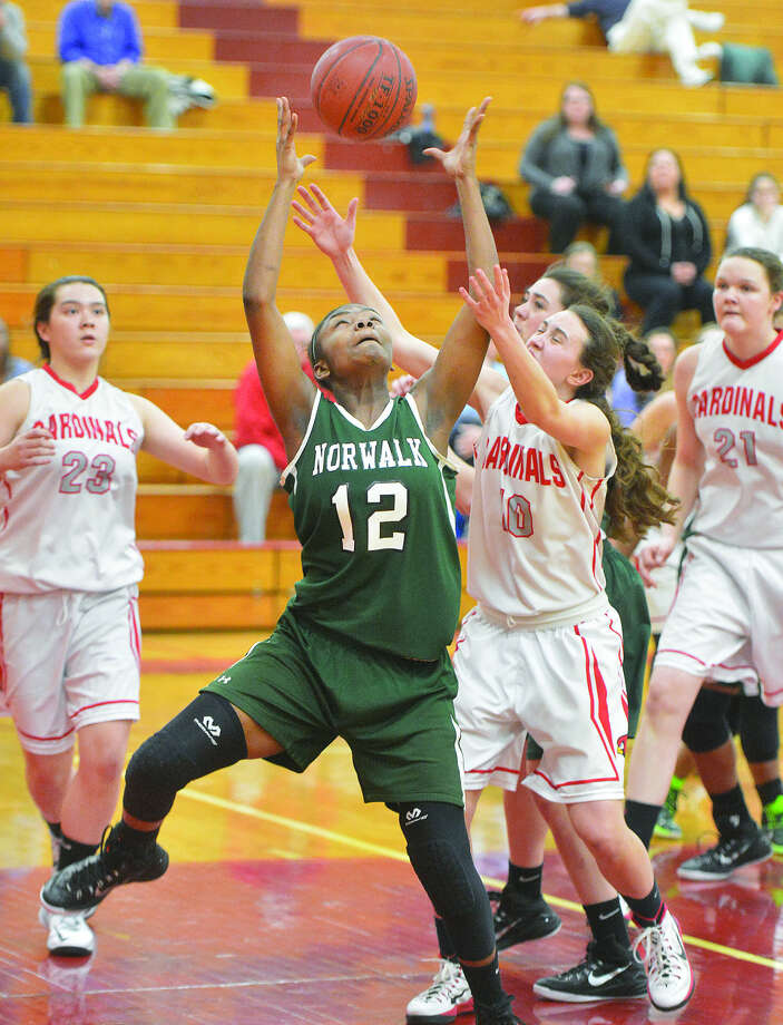 Norwalk's Asiah Knight grabs a rebound in the Bears loss to Greenwich on Wednesday night. (Hour photo/Alex von Kleydorff)
