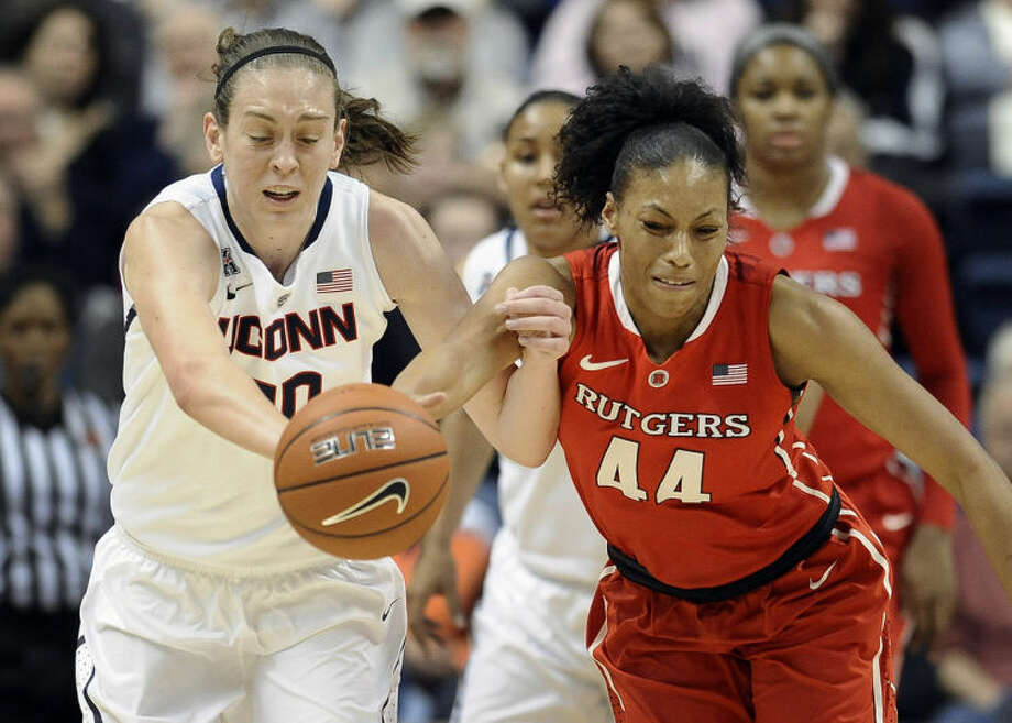 Connecticut's Breanna Stewart, left, steals the ball from Rutgers' Betnijah Laney, right, during the first half an NCAA college basketball game, Saturday, March 1, 2014, in Storrs, Conn. (AP Photo/Jessica Hill)