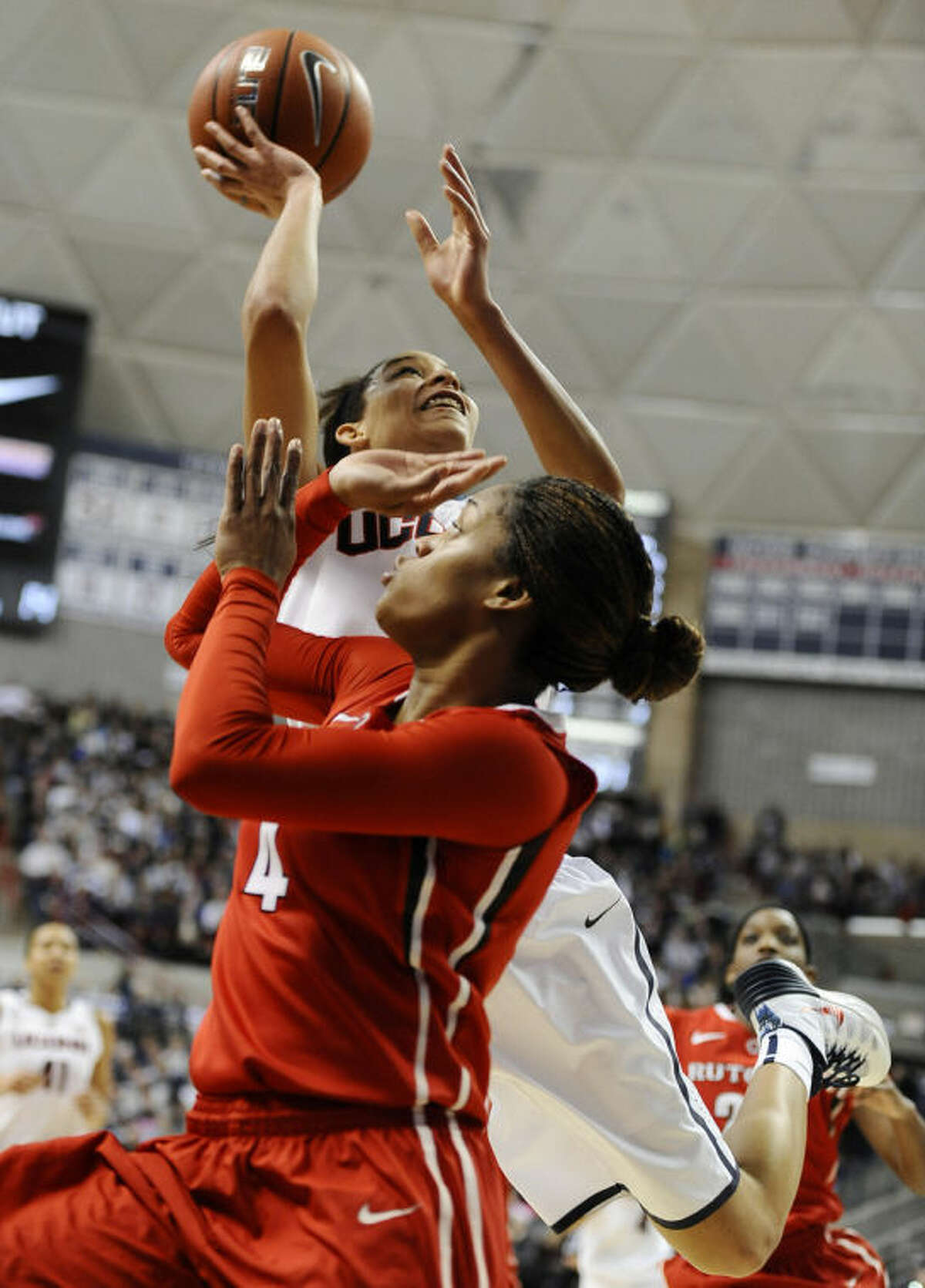Connecticut's Bria Hartley, back, is fouled by Rutgers' Briyona Canty during the first half an NCAA college basketball game, Saturday, March 1, 2014, in Storrs, Conn. (AP Photo/Jessica Hill)