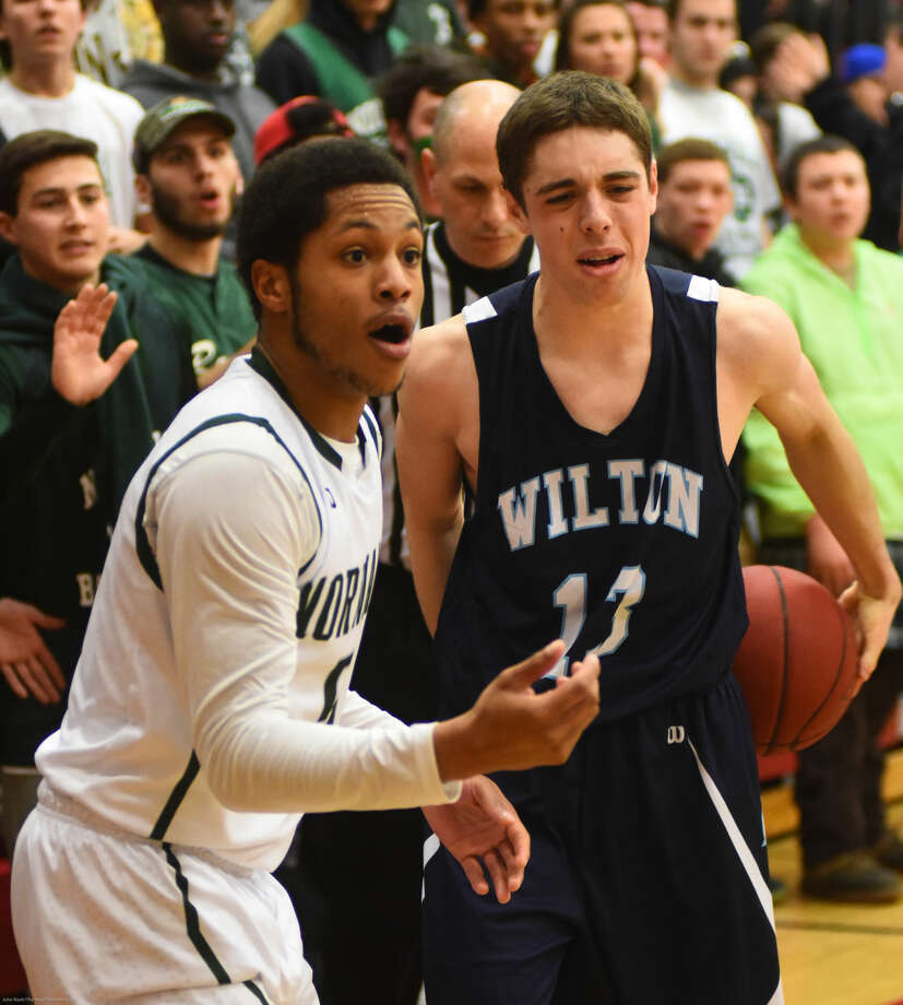 Hour photo/John Nash - Action from the FCIAC Boys Basketball Semifinal between Norwalk and Wilton. Norawlk won the game, 69-55.