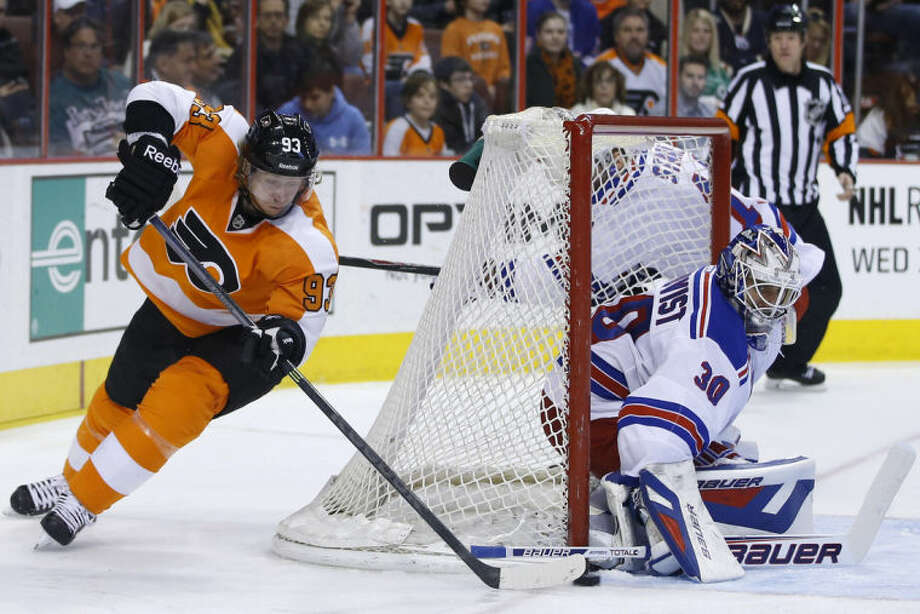 New York Rangers' Henrik Lundqvist, right, blocks a shot by Philadelphia Flyers' Jakub Voracek during the second period of an NHL hockey game, Saturday, March 1, 2014, in Philadelphia. (AP Photo/Matt Slocum)